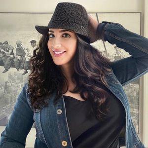 Black fedora hat with white pinstripes